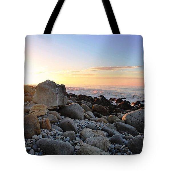 Beach Sunrise Over Rocks Tote Bag by Matt Harang