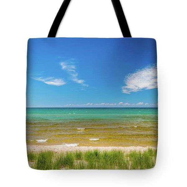 Tote Bag featuring the photograph Beach With Blue Skies And Cloud by Lester Plank