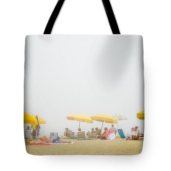 Beachgoers On A Foggy Day Tote Bag