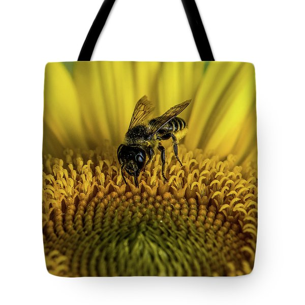 Tote Bag featuring the photograph Bee In A Sunflower by Paul Freidlund