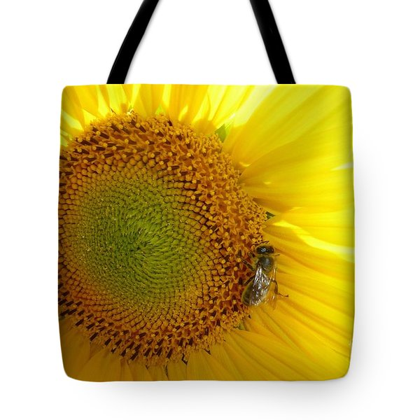 Tote Bag featuring the photograph Bee On Sunflower by Jean Bernard Roussilhe