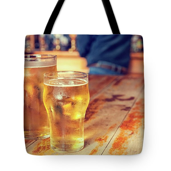 Tote Bag featuring the photograph Beers In A Pub by Patricia Hofmeester