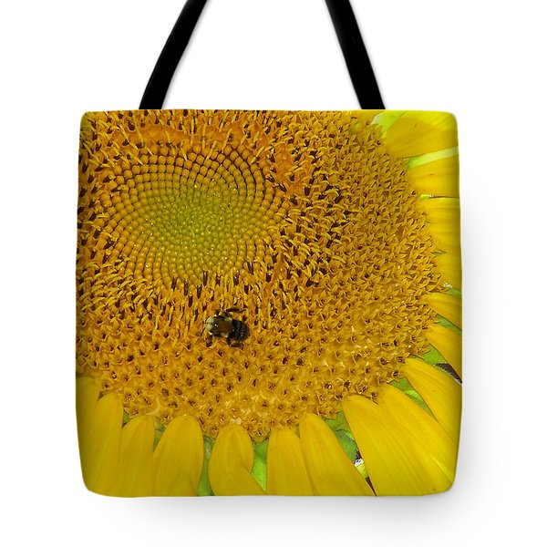 Tote Bag featuring the photograph Bees Share A Sunflower by Sandi OReilly