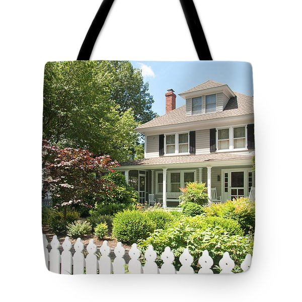 Tote Bag featuring the photograph Behind The Picket Fence by Charles Kraus