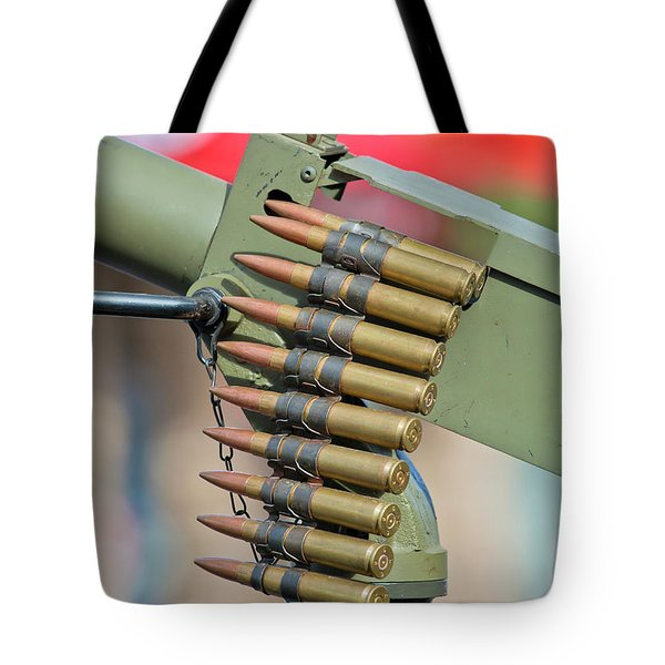 Tote Bag featuring the photograph Belt Of Rounds by Chris Dutton