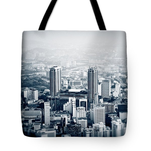 Tote Bag featuring the photograph Berjaya by Joseph Westrupp