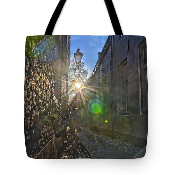 Tote Bag featuring the photograph Bicycle Alley by Frans Blok