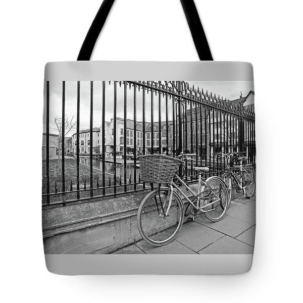 Tote Bag featuring the photograph Bicycles On Magdalene Bridge Cambridge In Black And White by Gill Billington