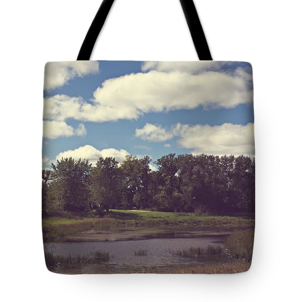 Tote Bag featuring the photograph Big Clouds by Cendrine Marrouat