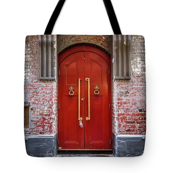Tote Bag featuring the photograph Big Red Doors by Perry Webster