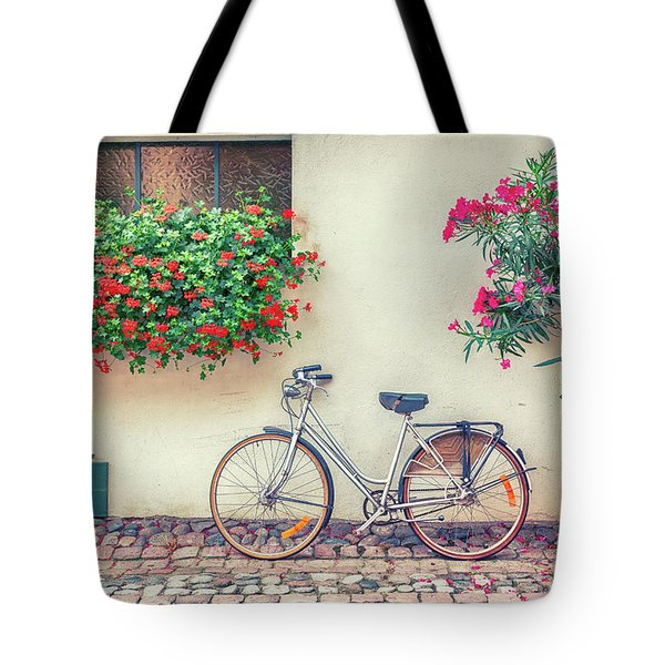 Tote Bag featuring the photograph bike in France village  by Ariadna De Raadt