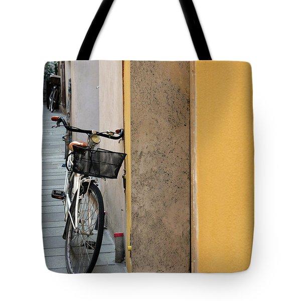 Bike Near A Yellow Wall In Foligno, Italy Tote Bag