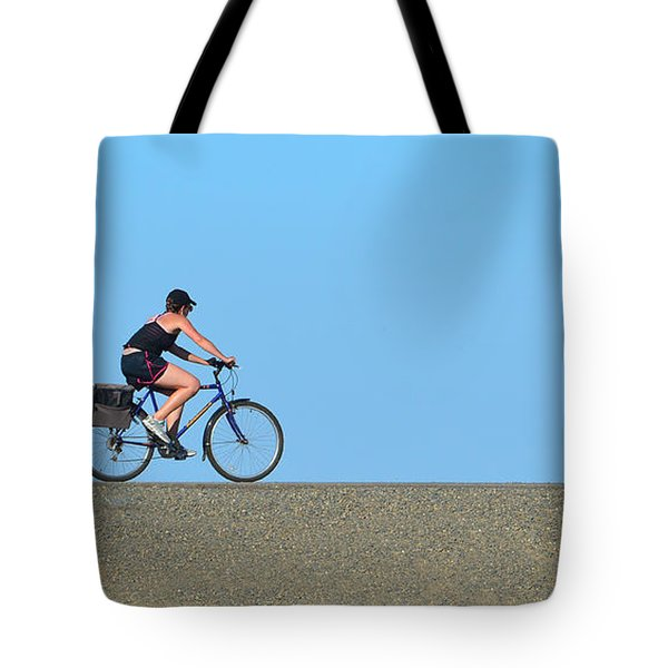Bike Rider On Levee Tote Bag by Josephine Buschman