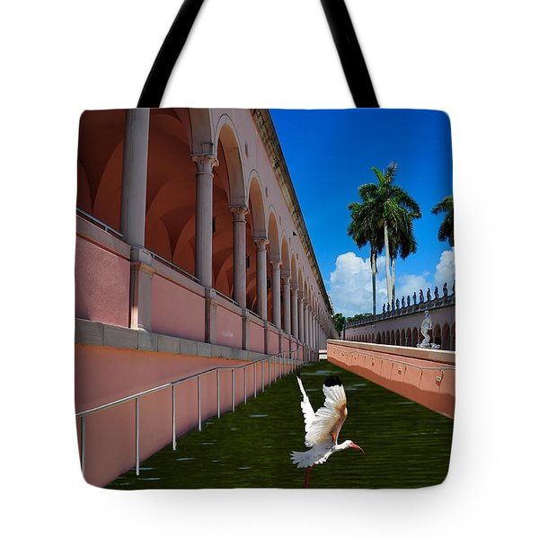 Tote Bag featuring the photograph Bird In Flight by Harry Spitz