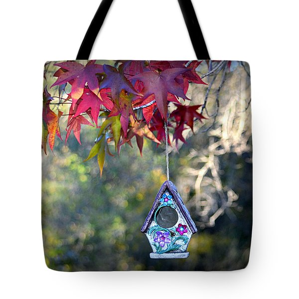 Tote Bag featuring the photograph Birdhouse Under The Autumn Leaves by AJ Schibig