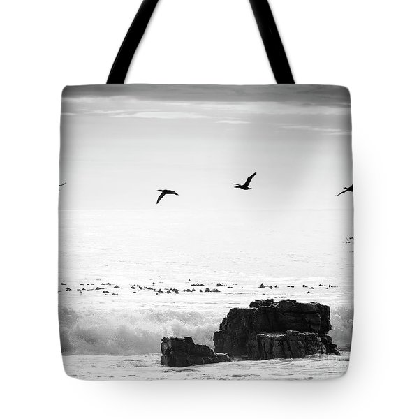 Tote Bag featuring the photograph Birds Flying Over Ocean Black And White by Tim Hester