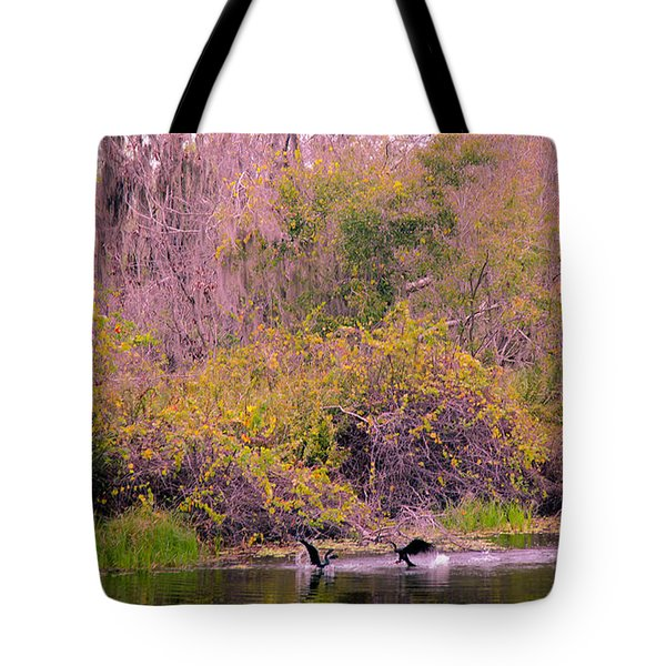 Tote Bag featuring the photograph Birds Playing In The Pond 2 by Madeline Ellis