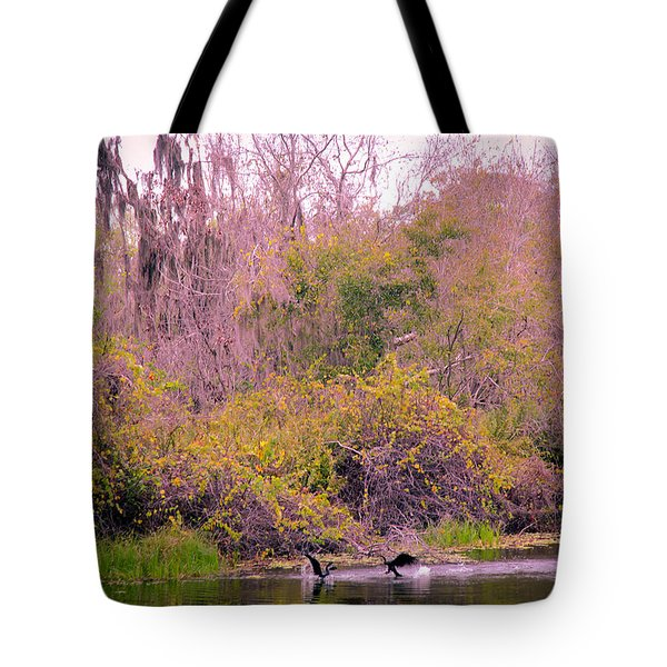 Tote Bag featuring the photograph Birds Playing In The Pond 1 by Madeline Ellis