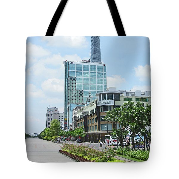 Tote Bag featuring the photograph Bitexco Financial Tower, by Gregg Cestaro