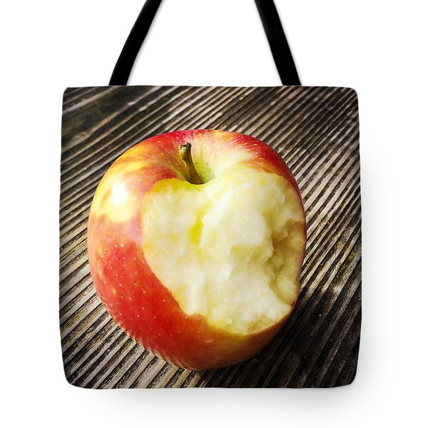 Bitten Red Apple Tote Bag by Matthias Hauser