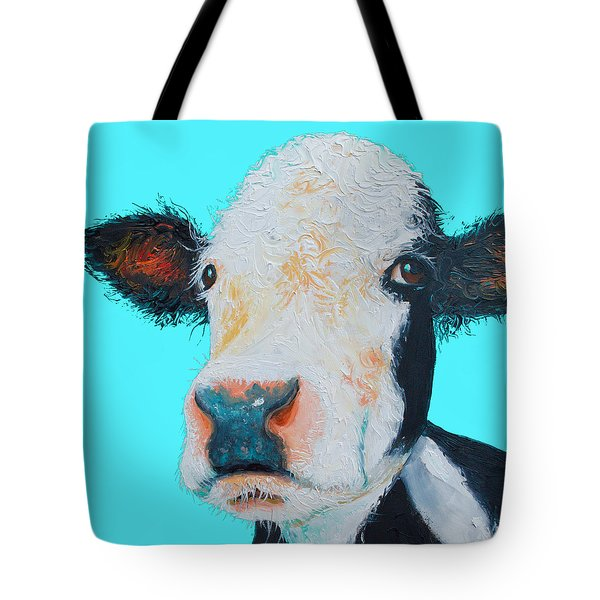 Black And White Cow On Blue Background Tote Bag by Jan Matson