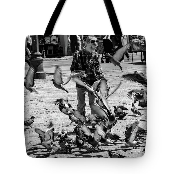 Black And White Of Boy Feeding Pigeons In Sarajevo, Bosnia And Herzegovina  Tote Bag
