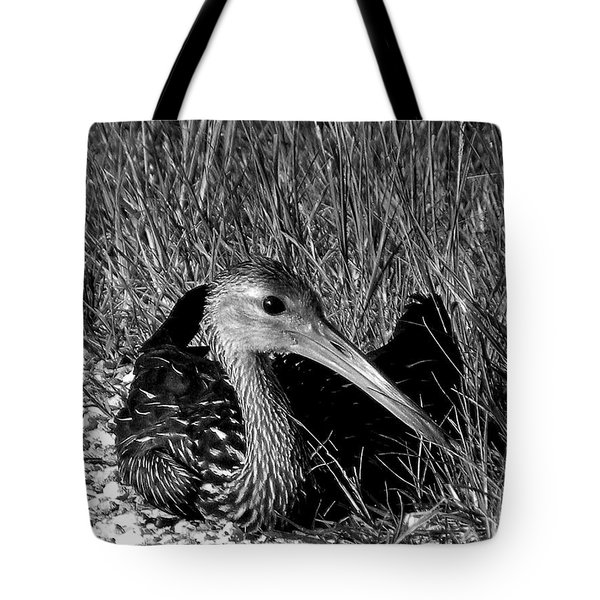 Black And White Resting Limpkin Bird Tote Bag by Chris Mercer