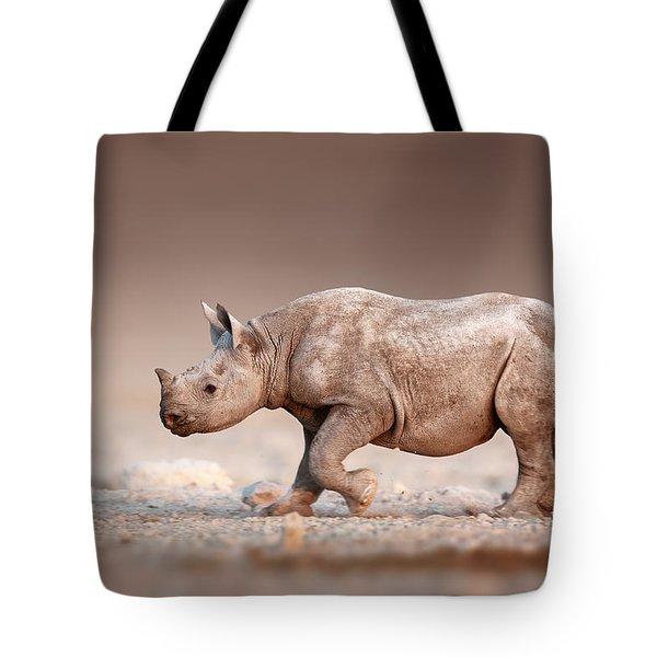 Black Rhinoceros Baby Running Tote Bag
