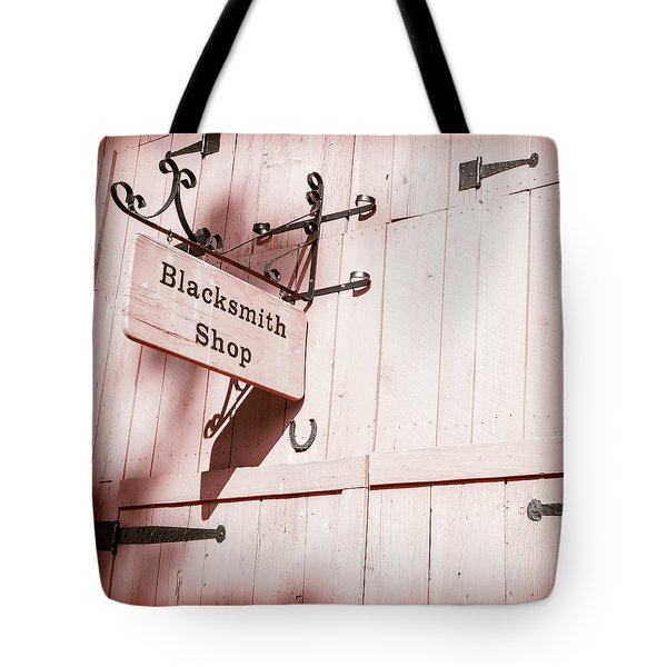 Tote Bag featuring the photograph Blacksmith Shop by Alexey Stiop