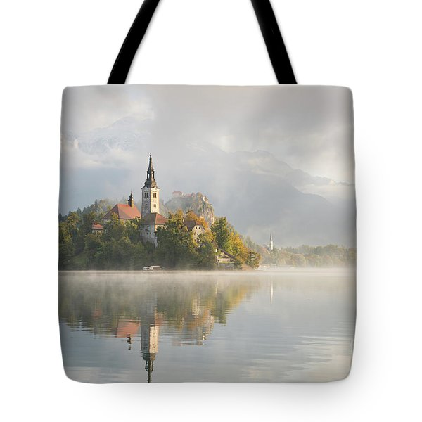 Tote Bag featuring the photograph Bled Lake On A Beautiful Foggy Morning by IPics Photography