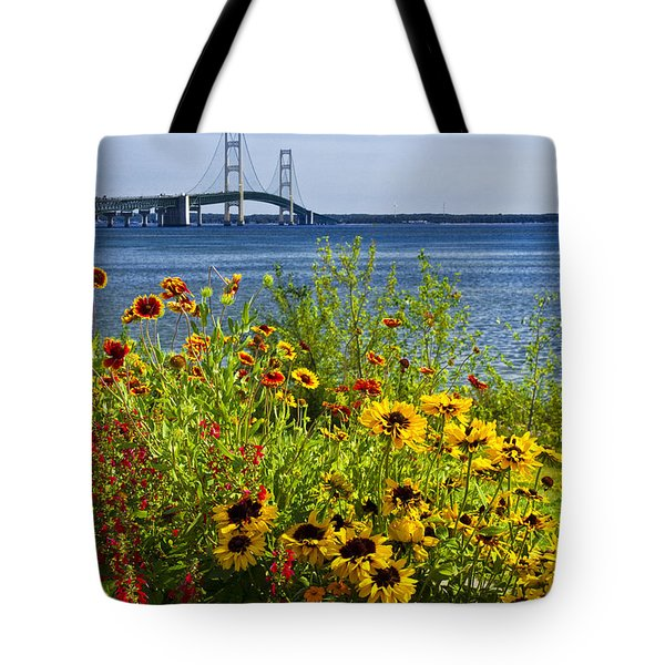 Blooming Flowers By The Bridge At The Straits Of Mackinac Tote Bag by Randall Nyhof