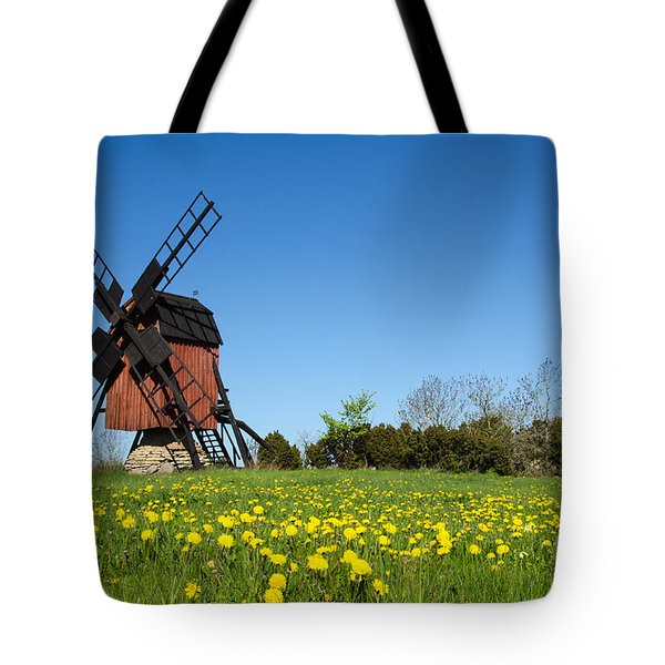 Tote Bag featuring the photograph Blossom Dandelions By A Traditional Windmill by Kennerth and Birgitta Kullman