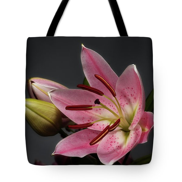 Blossoming Pink Lily Flower On Dark Background Tote Bag