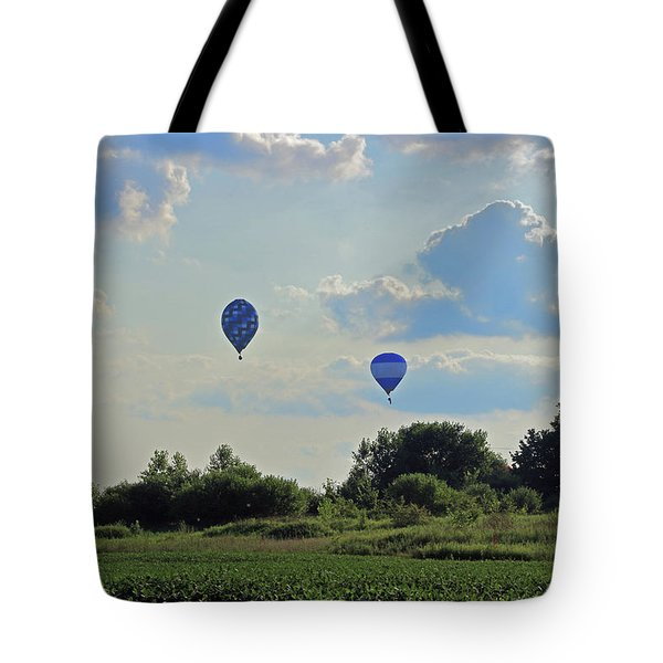 Tote Bag featuring the photograph Blue Balloons Over A Field by Angela Murdock