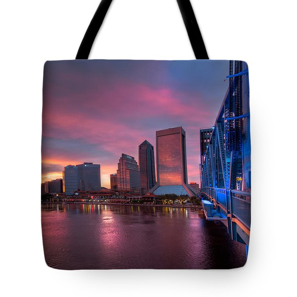 Blue Bridge Red Sky Jacksonville Skyline Tote Bag by Debra and Dave Vanderlaan