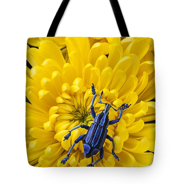 Blue Bug On Yellow Mum Tote Bag by Garry Gay