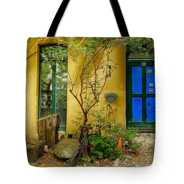 Tote Bag featuring the photograph Blue Door by Uri Baruch