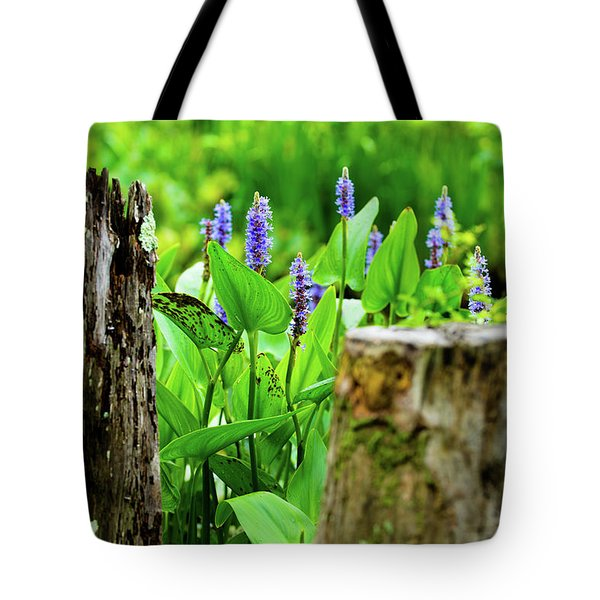 Tote Bag featuring the photograph Blue Flowers And Artistic Logs by Dennis Dame