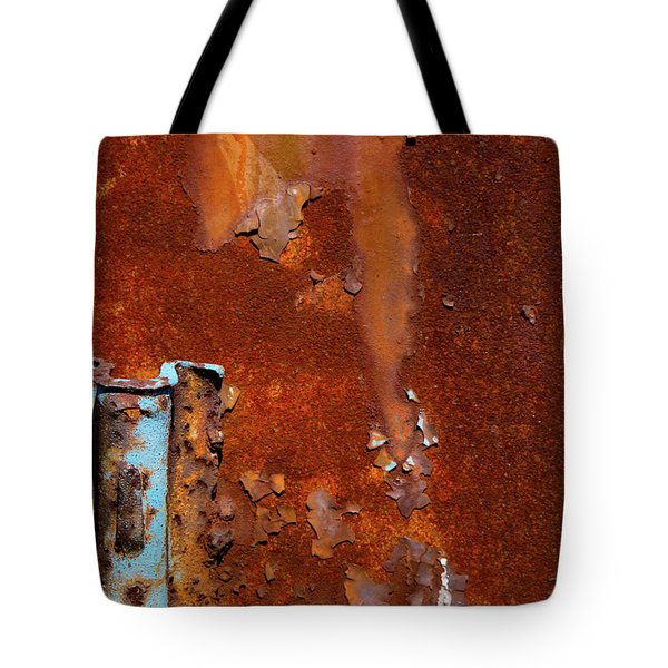 Tote Bag featuring the photograph Blue On Rust by Karol Livote