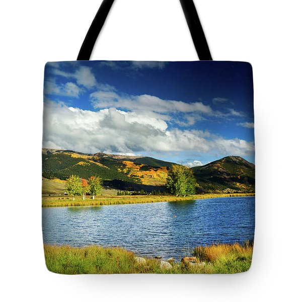 Tote Bag featuring the photograph Blue Skies Over Crested Butte by John De Bord