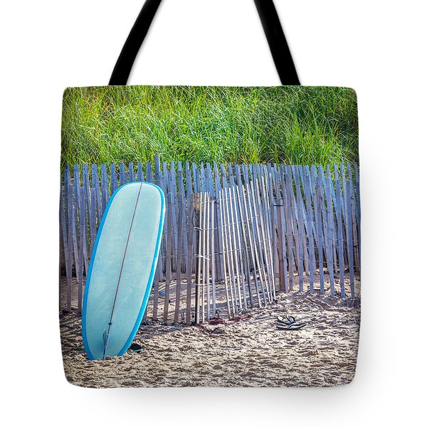 Tote Bag featuring the photograph Blue Surfboard At Montauk by Art Block Collections