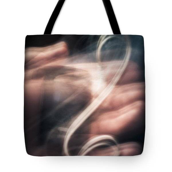 Blurry Human Hand Holding Distorted Music Player Tote Bag