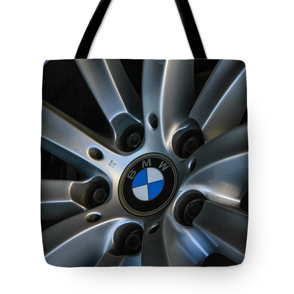 Tote Bag featuring the photograph Bmw Wheel by Robert Hebert
