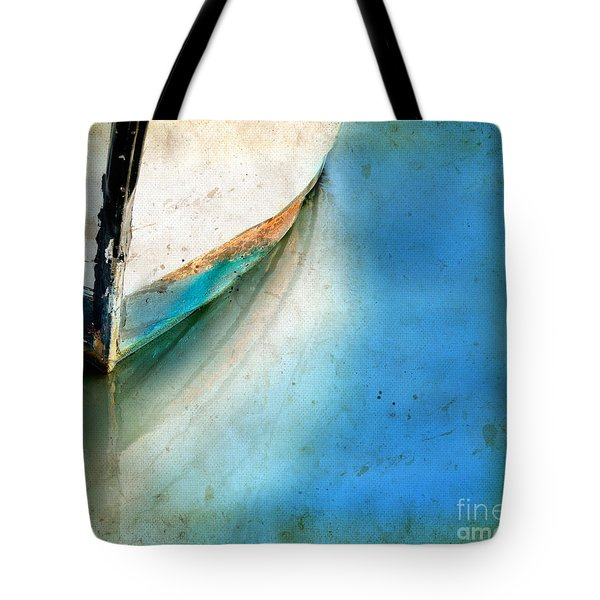 Tote Bag featuring the photograph Bow Of An Old Boat Reflecting In Water by Jill Battaglia