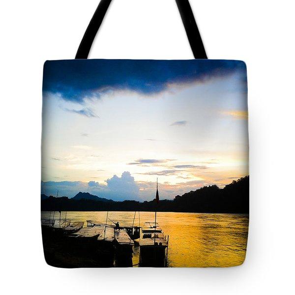 Boats In The Mekong River, Luang Prabang At Sunset Tote Bag