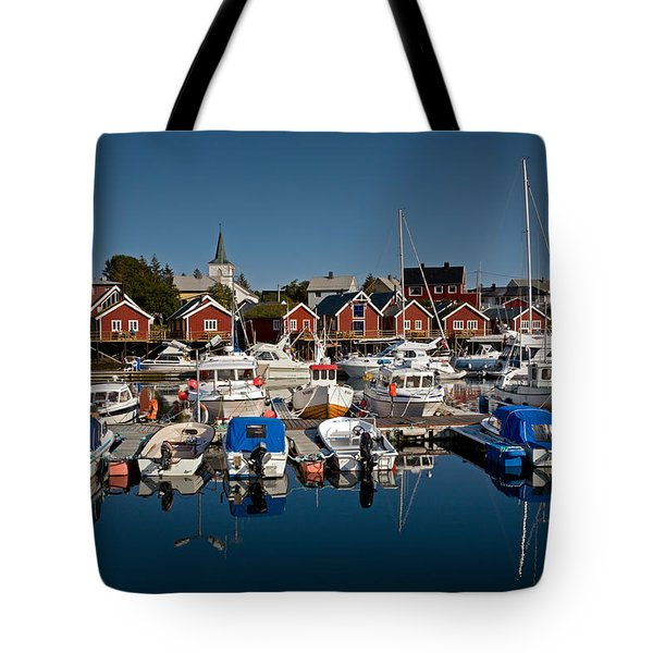 Boats With Reflections In Reine Port Tote Bag by Aivar Mikko