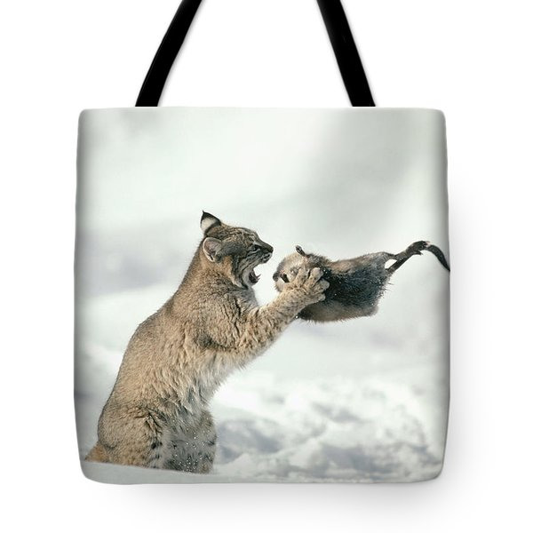 Bobcat Lynx Rufus Capturing Muskrat Tote Bag by Michael Quinton