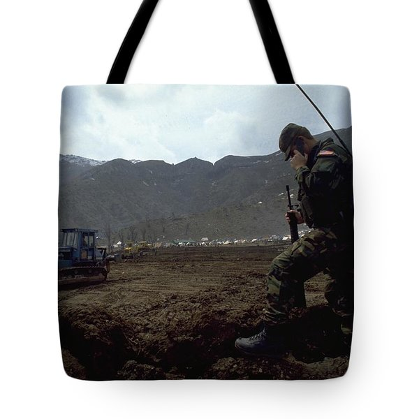 Tote Bag featuring the photograph Boots On The Ground by Travel Pics