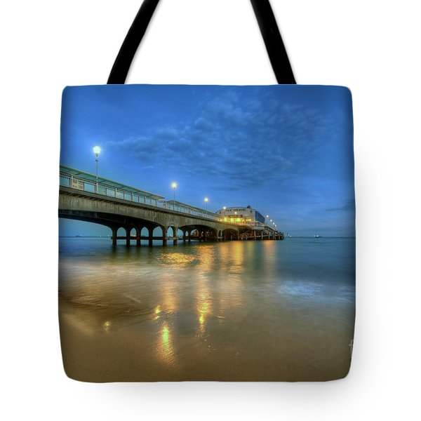Tote Bag featuring the photograph Bournemouth Pier Blue Hour by Yhun Suarez