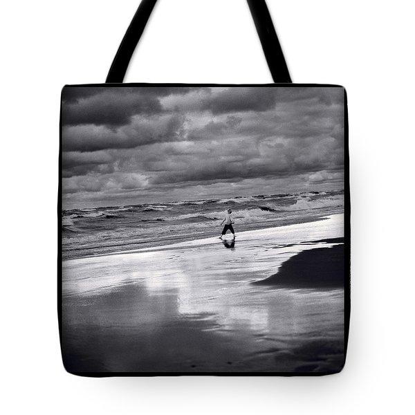 Boy On Shoreline Tote Bag by Steve Gadomski